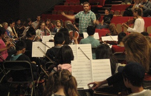 John Sims rehearsing with the Tower Hamlets Youth Orchestra